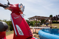 Piaggio Vespa - Wedding Tuscany - Swimming Pool. Piaggio Vespa enjoying the sun in Tuscany, Italy besides the pool. While a wedding ceremony is being prepared Stock Photo