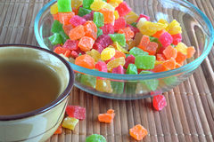 Piala with tea and a glass dish with candied fruit Stock Photography
