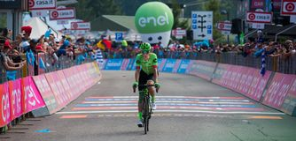 Piancavallo, Italy May 26, 2017: Professional Cyclist Pierre Rolland. Cannondale Team, exhausted passes the finish line after a hard montain stage of Tour of Royalty Free Stock Images