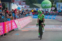 Piancavallo, Italy May 26, 2017: Professional Cyclist Pierre Rolland. Cannondale Team, exhausted passes the finish line after a hard montain stage of Tour of Royalty Free Stock Photos