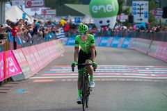 Piancavallo, Italy May 26, 2017: Professional Cyclist Pierre Rolland. Cannondale Team, exhausted passes the finish line after a hard montain stage of Tour of Stock Images