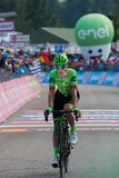 Piancavallo, Italy May 26, 2017: Professional Cyclist Pierre Rolland. Cannondale Team, exhausted passes the finish line after a hard montain stage of Tour of Royalty Free Stock Photo