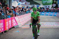 Piancavallo, Italy May 26, 2017: Professional Cyclist Pierre Rolland. Cannondale Team, exhausted passes the finish line after a hard montain stage of Tour of Stock Image