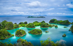 Pianemo Islands, Raja Ampat, West Papua, Indonesia. Pianemo Islands, Blue Lagoon with Green Rockes, Raja Ampat, West Papua. Indonesia stock photography