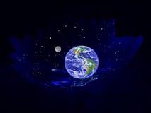 Pianeta la terra in una culla Immagine Stock