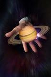 Pianeta Saturn delle mani Fotografia Stock
