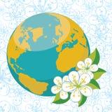 Pianeta Terra con i flovers della molla sul backgr dei fiori Immagini Stock