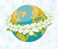 Pianeta Terra con l'orbita dei flovers. Backgrou della primavera Fotografie Stock