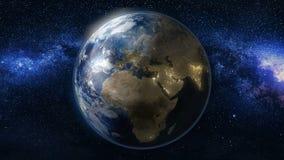 Pianeta Terra in universo nero e blu della stella Immagini Stock