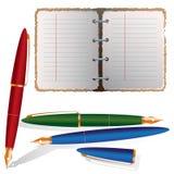 Pianificatore con tre penne Fotografie Stock Libere da Diritti