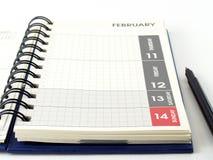 Pianificatore e penna del diario su fondo bianco Fotografia Stock