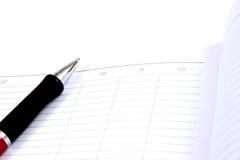 Pianificatore e penna della casella di affari Fotografie Stock Libere da Diritti