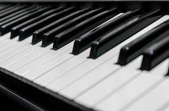 Pianino wpisuje zakończenie na całości ramy Obrazy Stock