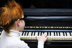 Pianist. The boy plays on the piano Royalty Free Stock Photography
