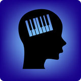 Pianist. Keyboard or piano keys inside the developing brain Royalty Free Stock Photo