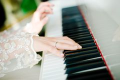 Pianist. Hands of the bride pianist stock photo