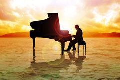 Pianist. Stock image of a man silhouette playing piano on water Stock Photos