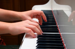Pianist. Hands of the musician playing on the piano Stock Photos