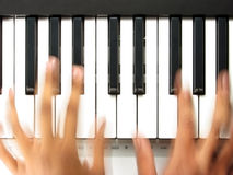 Pianist in action, playing a piano Royalty Free Stock Image