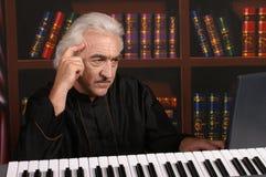 Pianist in black Stock Image