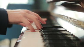 Pianist in blue suit plays rapidly on the piano stock footage