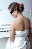 Pianist in der Maske Stockbild