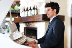 Pianist in a fine restaurant Royalty Free Stock Images