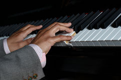 Pianist fingers playing Stock Photo