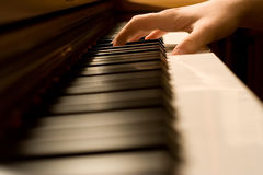 Pianist hand on a keyboard. The hand on piano keyboard Stock Images