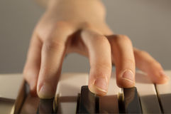 Pianist hand. With piano keyboard Stock Photo