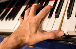Pianist hand playing a chord. Stock Photography