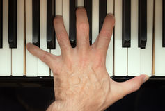 Pianist hand playing a chord. Stock Photo