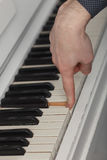 Pianist hand touching one of the piano keys. Royalty Free Stock Photo