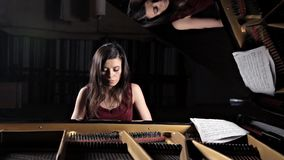 Pianist musician piano music playing. Musical instrument grand piano with woman performer.  stock video footage