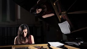 Pianist musician piano music playing. Musical instrument grand piano with woman performer.  stock footage