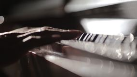 Pianist open piano lid and touching keyboard with passion.