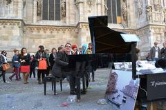 Pianist Paolo Zanarella gives free music street show playing his grand piano at the Duomo of Milan. stock images