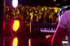 The pianist, piano and the spotlight in the concert and the dancing audience Royalty Free Stock Image