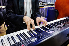 Pianist playing on digital piano Royalty Free Stock Photos