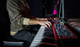 Pianist playing electric piano on concert Royalty Free Stock Photo