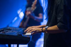 Pianist playing electric piano in concert, music concept. Pianist playing electric piano in concert at night, music concept Stock Images