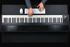 Pianist playing electric piano with jacket Royalty Free Stock Images