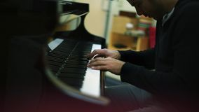 Pianist playing a Grand Piano with great sentiment stock video footage