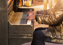 Pianist playing outdoors Royalty Free Stock Images