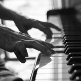 Pianist playing piano Stock Images