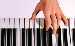 Pianist playing on a synthesizer, isolated on a gradient gray Stock Photo