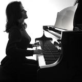 Pianist plays grand piano Stock Photography