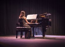 Pianist on stage at a piano concert stock photos