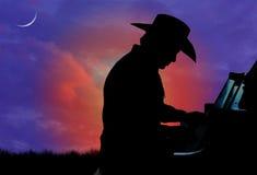 pianista kowbojska sylwetka Zdjęcia Royalty Free