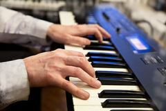 Pianists hands and piano keyboard Royalty Free Stock Photography